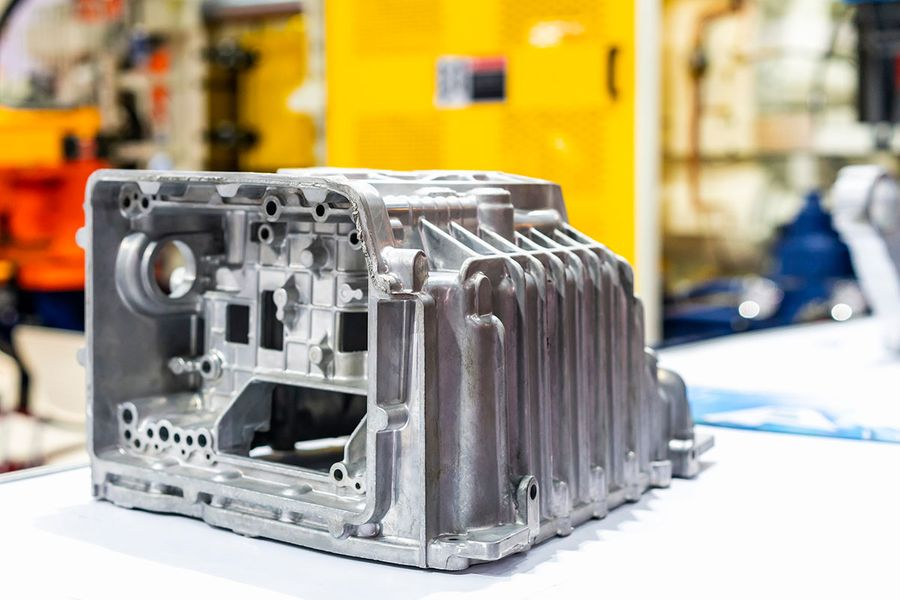 Canva---aluminum-alloy-cove-crankcase-engine-part-for-automobile-or-vehicle-before-machining-made-from-high-pressure-die-casting-process-on-table.jpg