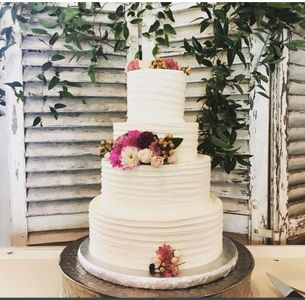 4 tier wedding cake flowers.jpeg