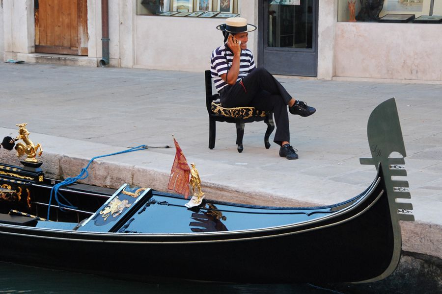 Venice, Gondoliere on his cell phone.jpg
