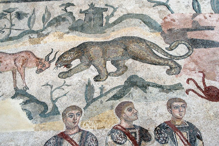 Sicily, Piazza Armerina leopard with three men.jpg