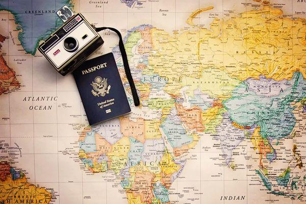 Passport, camera and map
