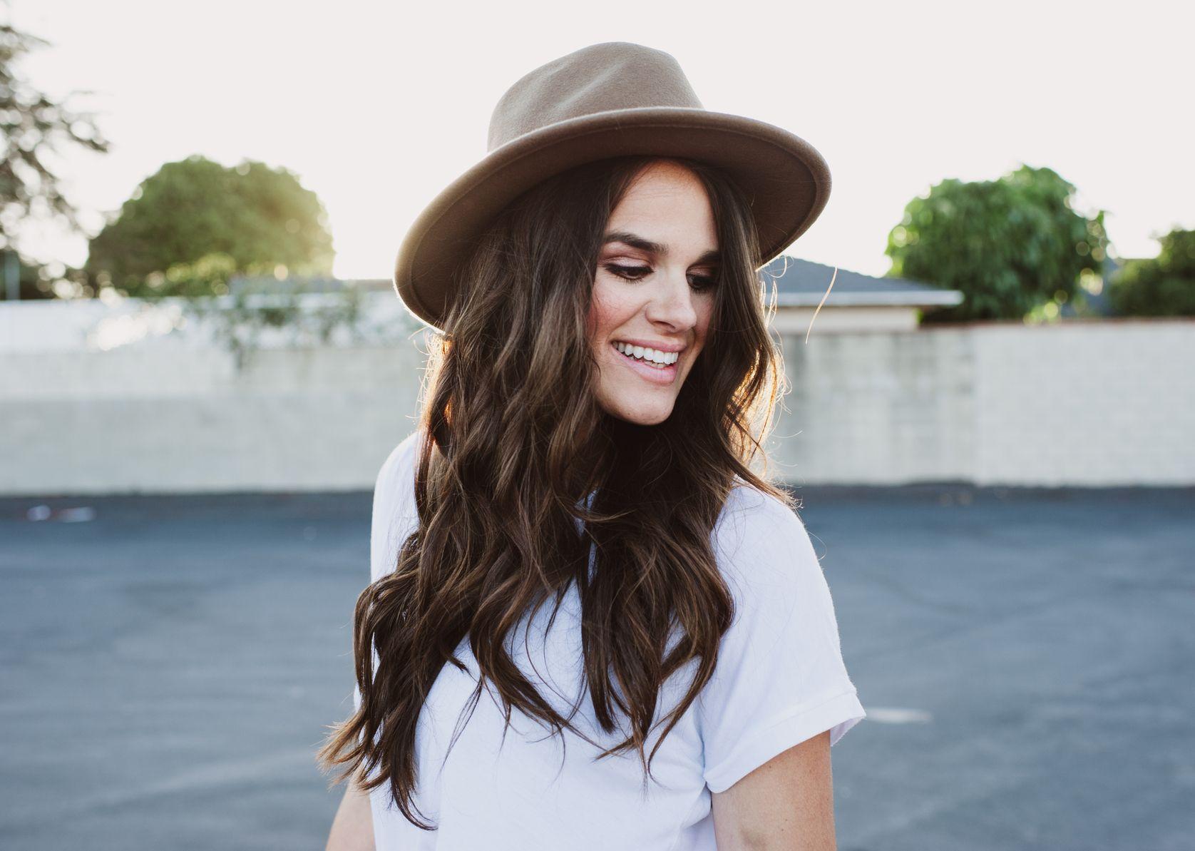 BRUNETTE SMILE WITH HAT.jpg