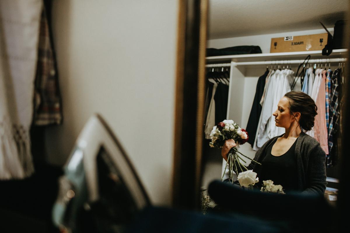 bride making bouquet