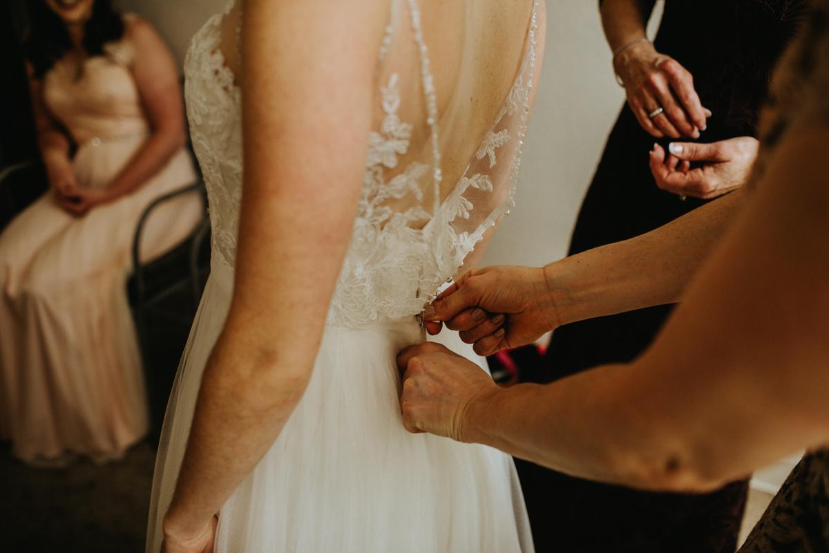 bride putting dress on austin texas