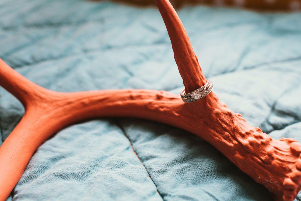 wedding ring on antler