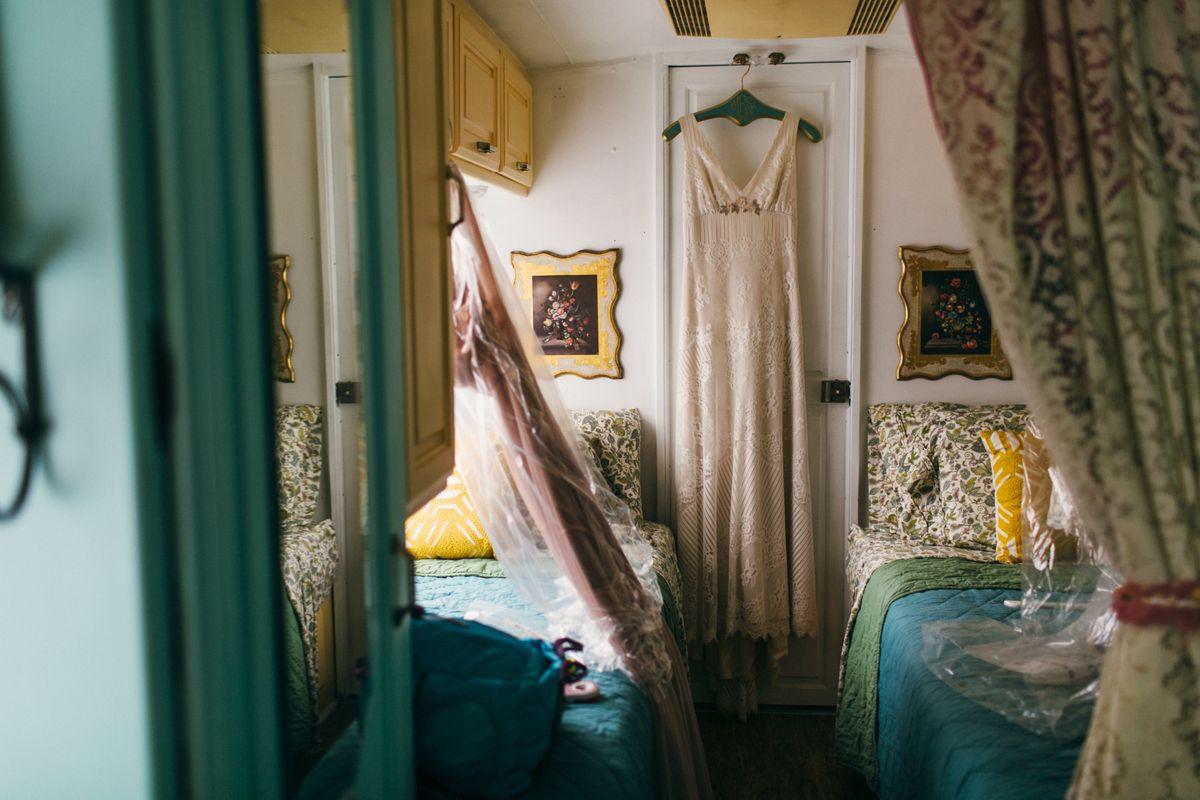 wedding dress hanging in airstream trailer