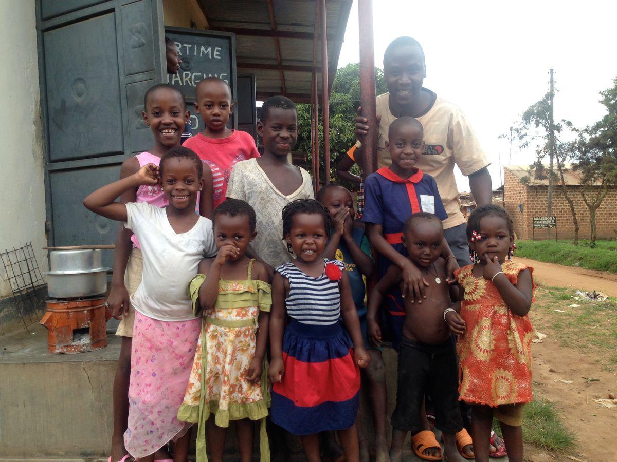 Pastor Gerald with children in Bweya village
