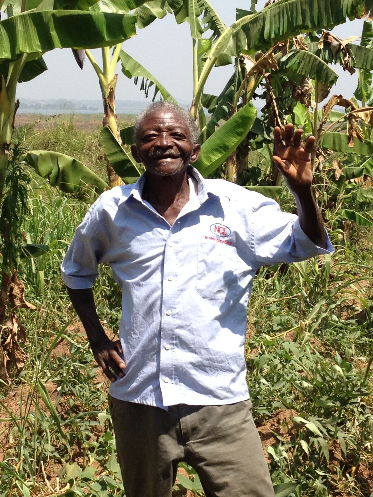 """Muzeeyi (word for """"respected old man) Daniel showing his agricultural project to sustain his family"""