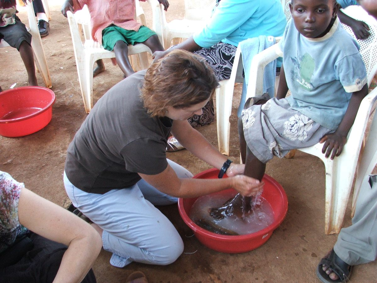 Washing feet & offering a new pair of shoes