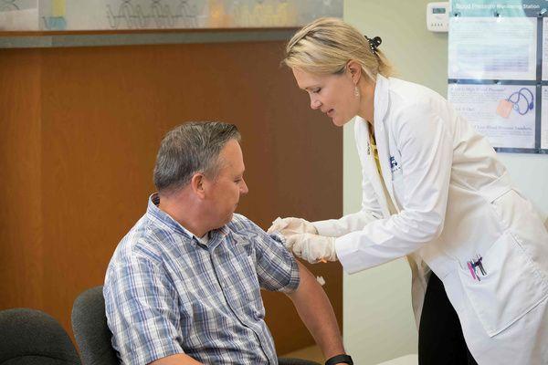 Pharmacist administering immunization