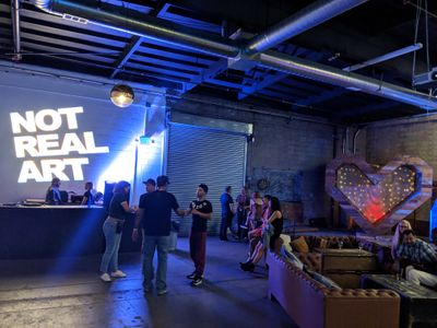An image of the Not Real Art party with a custom Not Real Art Gobo