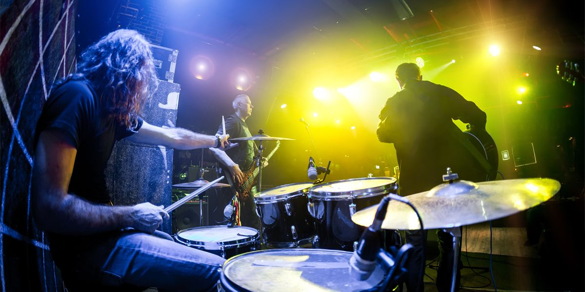 A summer playing drums at a live show