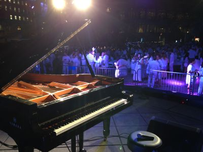 An image of a Yamaha piano on a stage