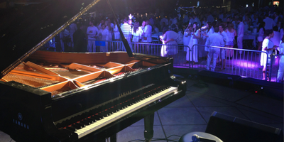 A large Yamaha piano on stage at a concert