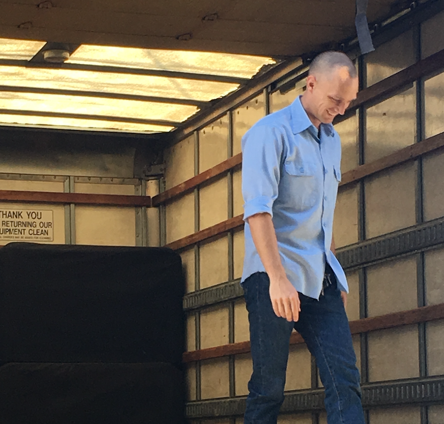Art McAuliffe loading A/V equipment onto a truck at TSV Sound & Vision