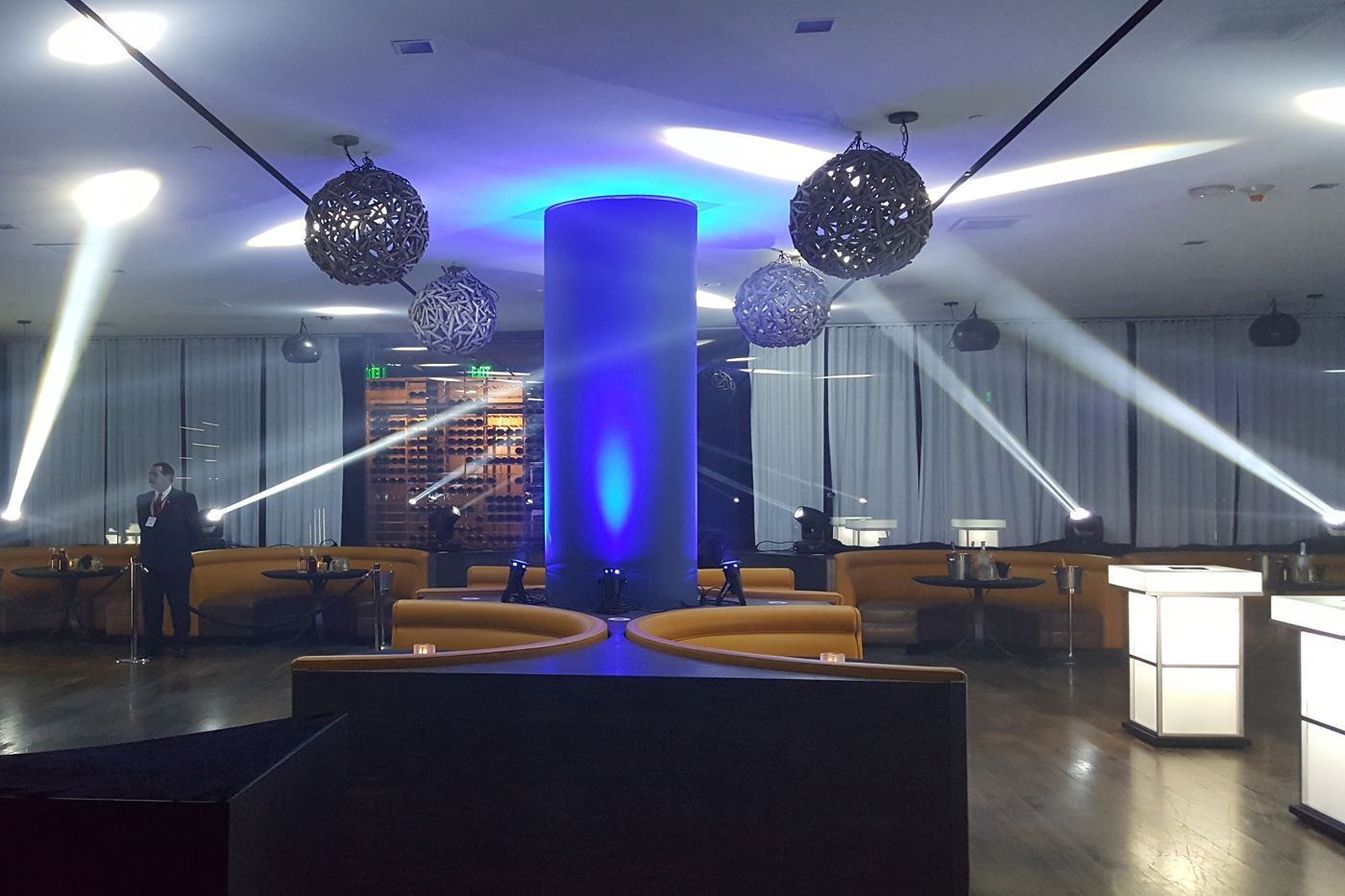 A lounge area at an event in the Sofitel Hotel with moving lights around the space