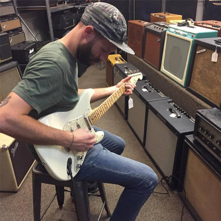 An image of Joel Dodson playing a Fender guitar
