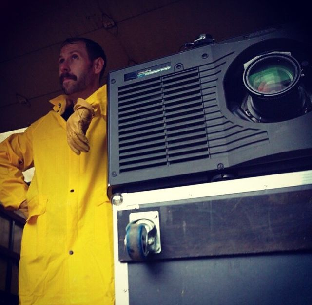 An image of Joel Dodson of TSV Sound & Vision in a yellow raincoat at an event in St. Louis