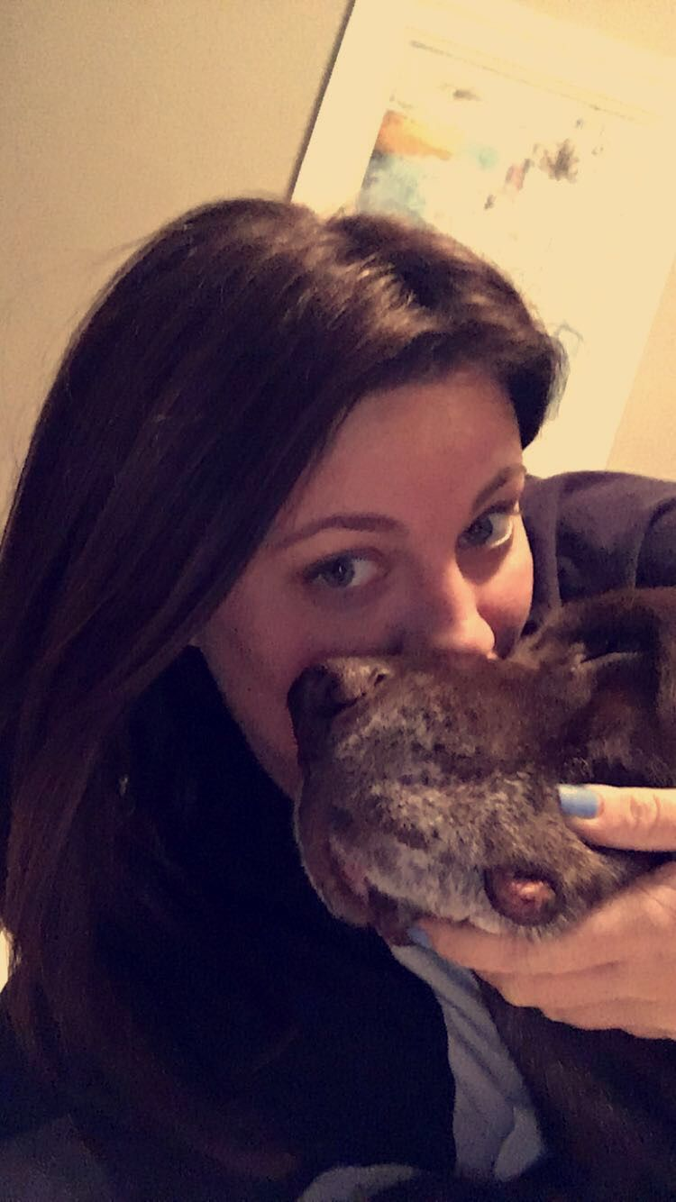An image of Lindsey Ascheman kissing a dog