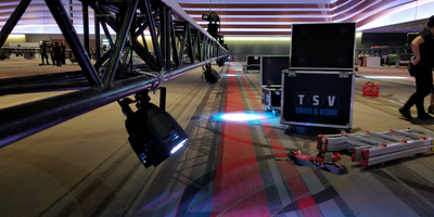 LED lights rigged to a truss at a corporate conference