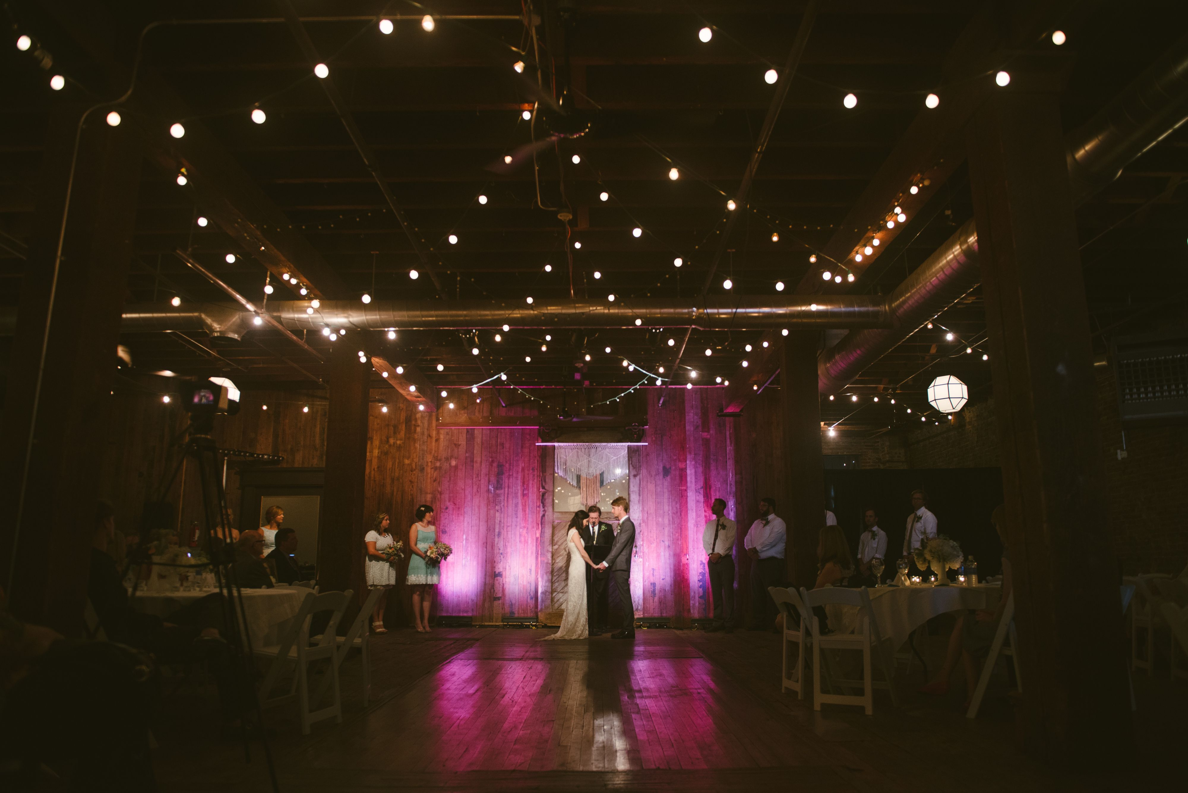 An image of a small wedding with bistro lights