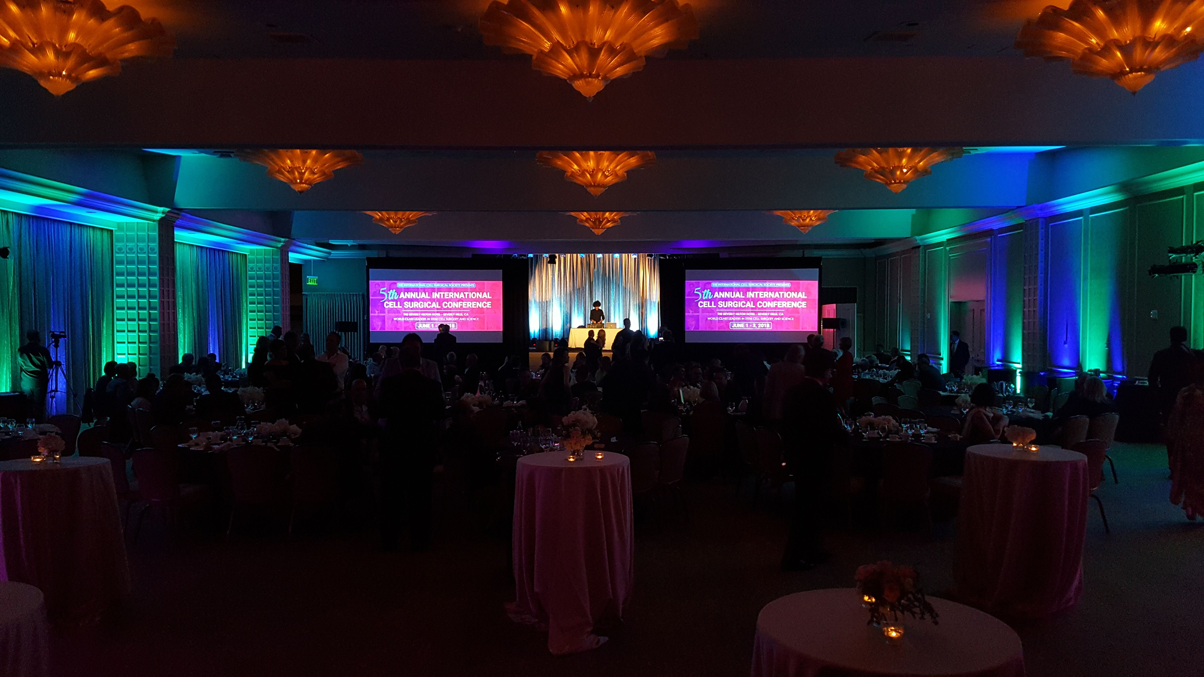 An image of uplighting at a gala in a hotel ballroom