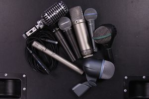 An image of a lot of wireless mics