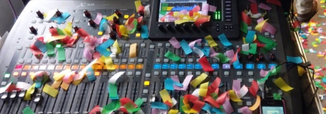 A small audio mixer with confetti on it