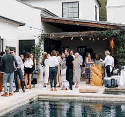 An image of an outdoor holiday party in Austin, Texas with string lighting provided by TSV