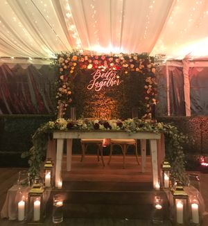 """Floral Design with """"Better Together"""" Sign at a wedding"""
