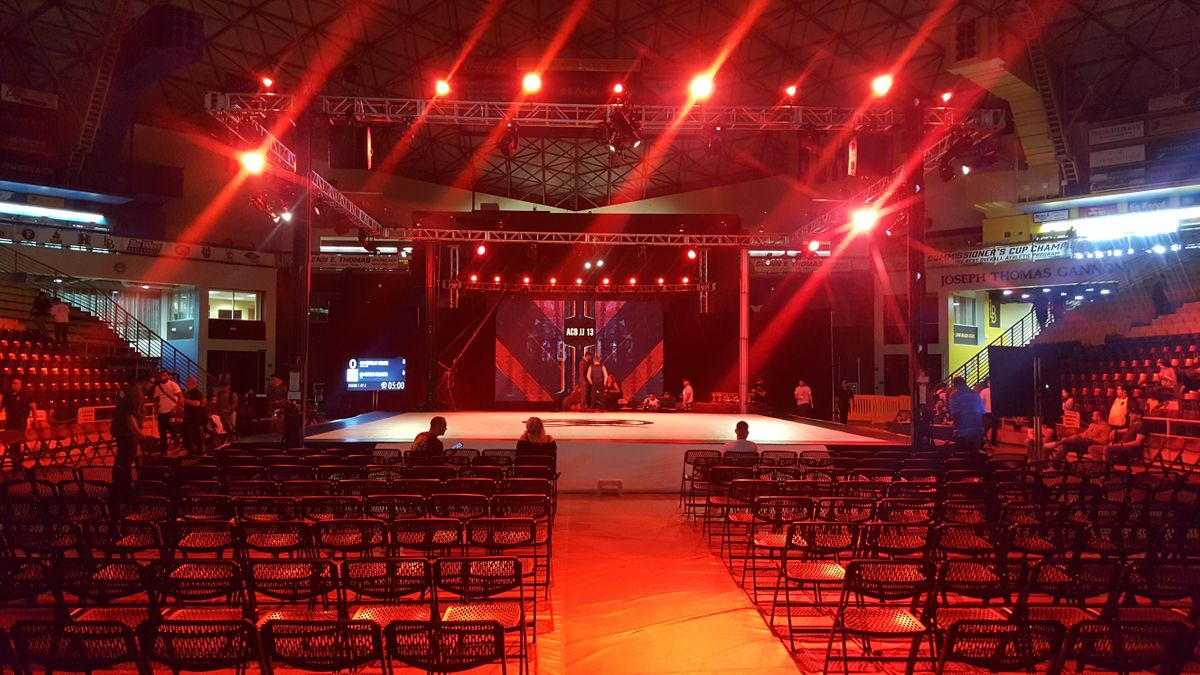 Red lighting and an LED display at a large event in Los Angeles.
