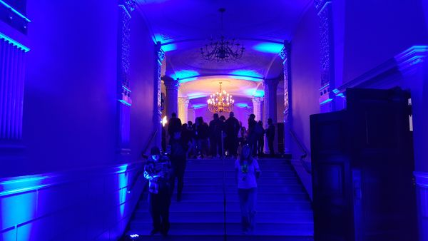 Blue lighting in a venue hallway