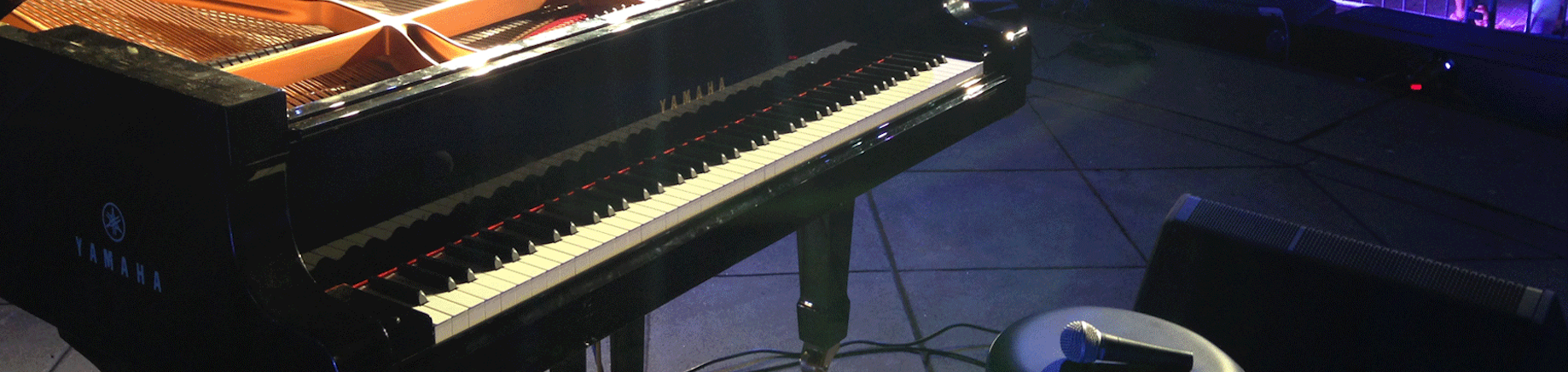 Close up of a Yamaha piano on stage