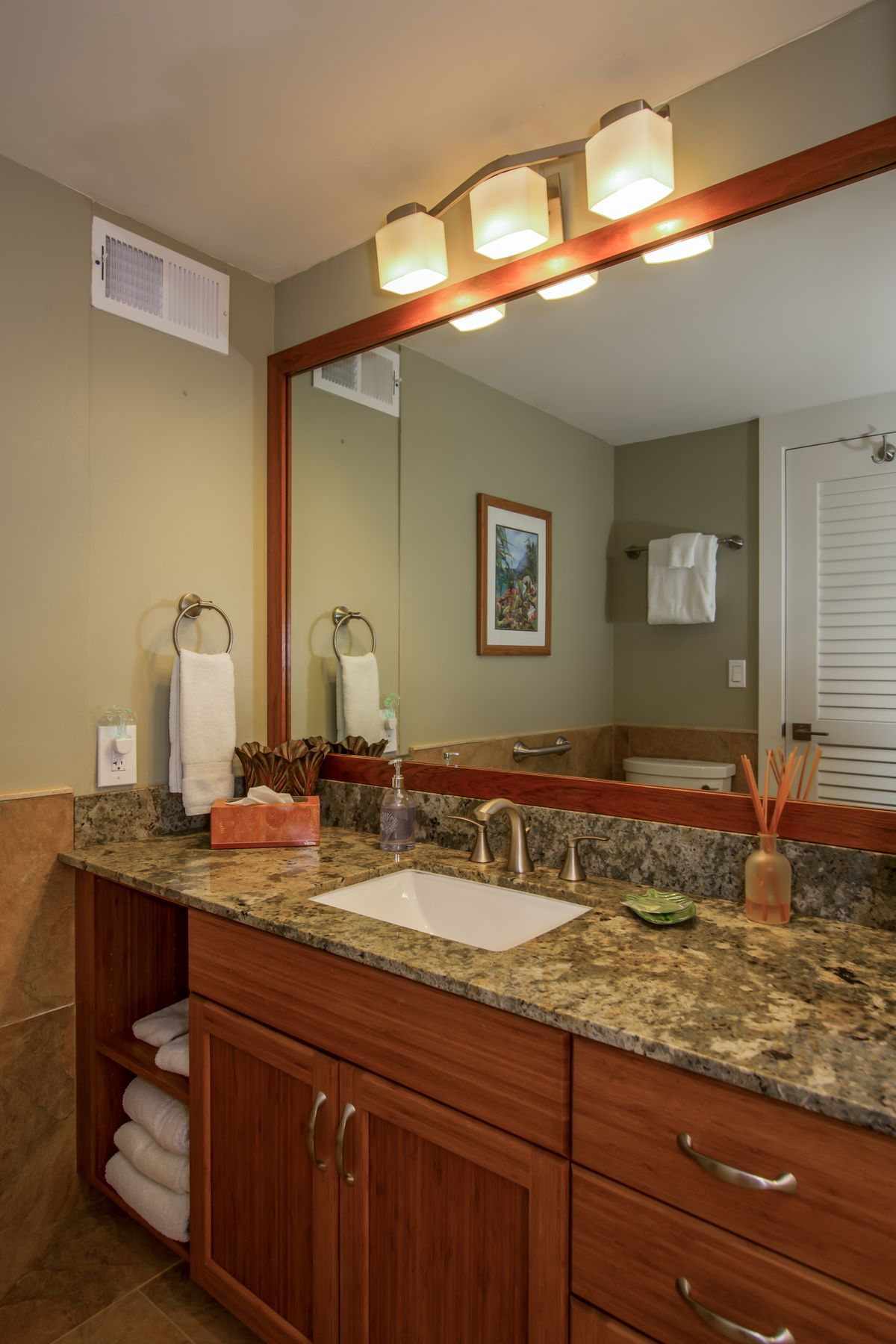 Bathroom with bamboo cabinets and granite counters