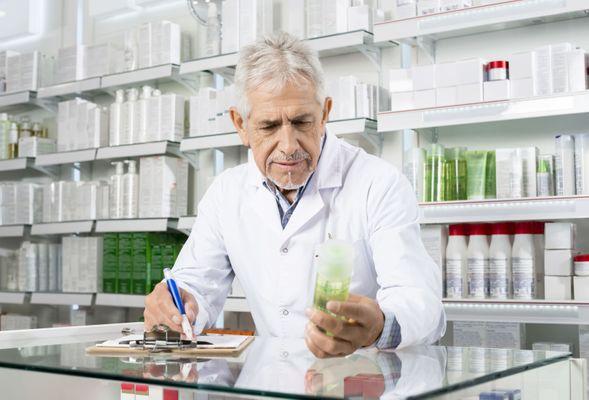 Pharmacist Reading Medication Label