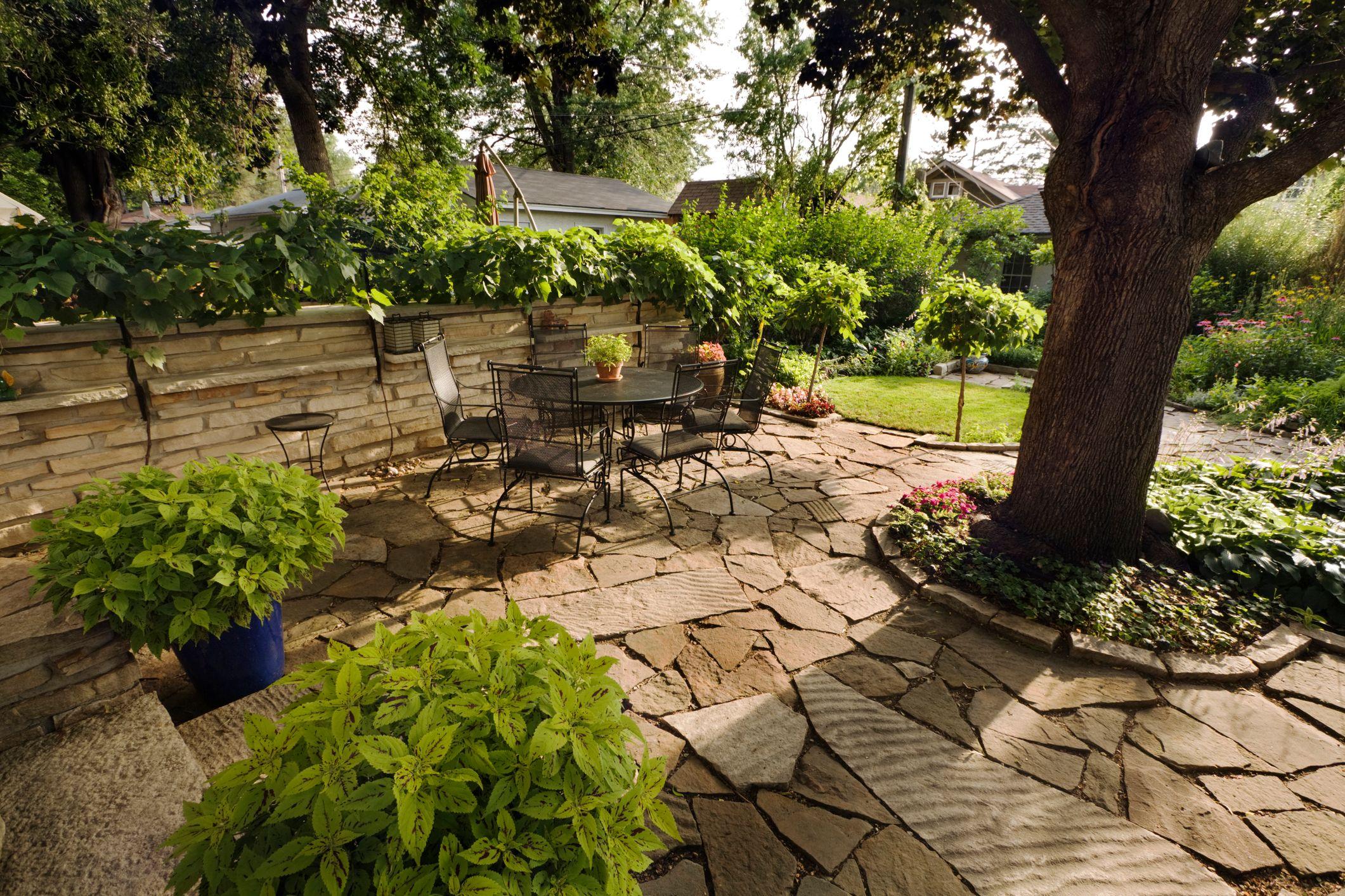Backyard patio with limestone landscaping stones