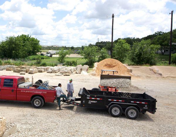 Loading bulk landscaping stones into trailer