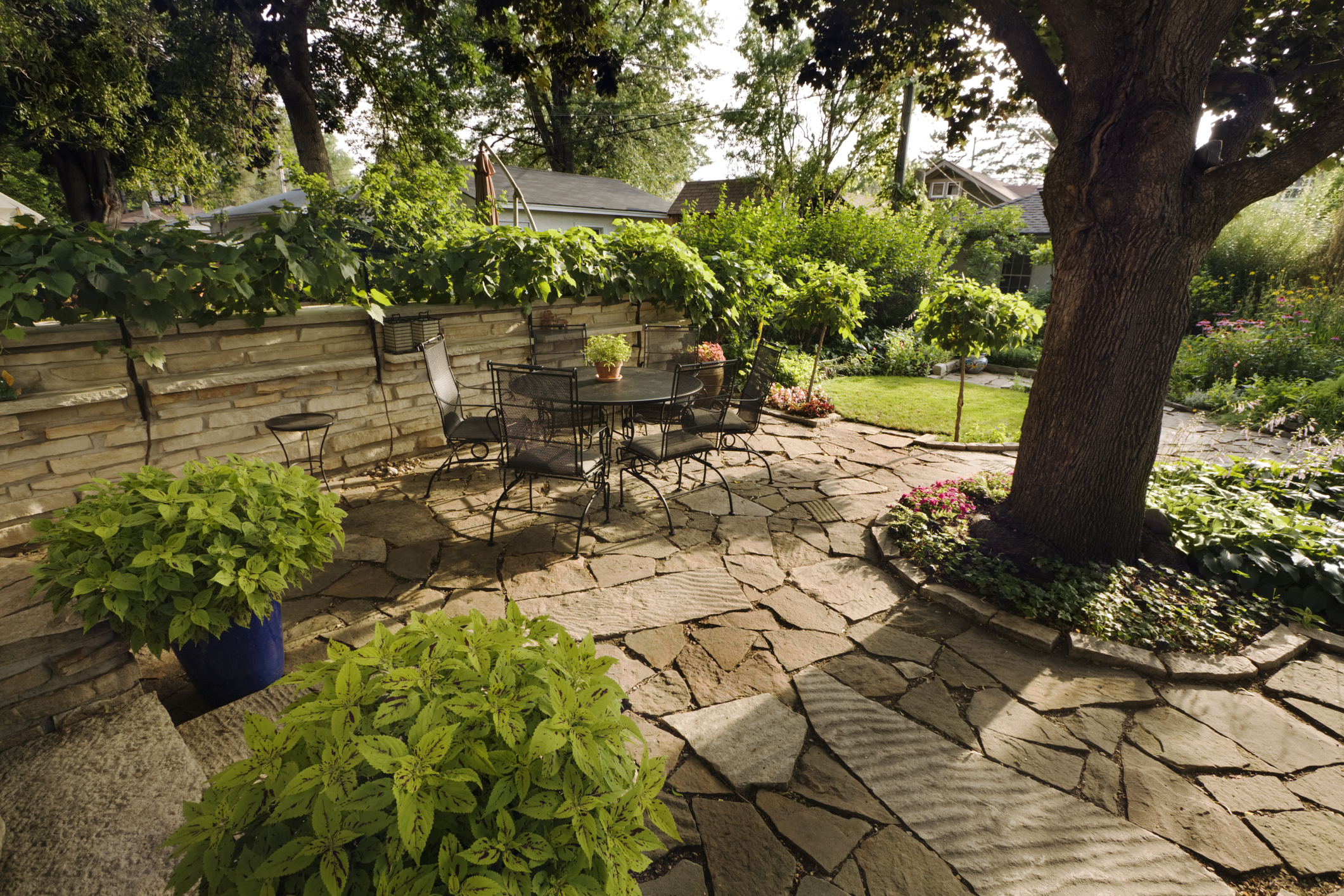 Backyard patio with limestone landscaping stones