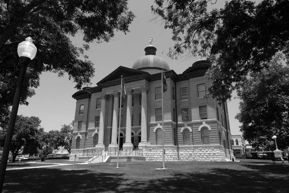 The historic Hays Country Courthouse, built in 1909, presides over a town square bustling with farmer's markets and local businesses.