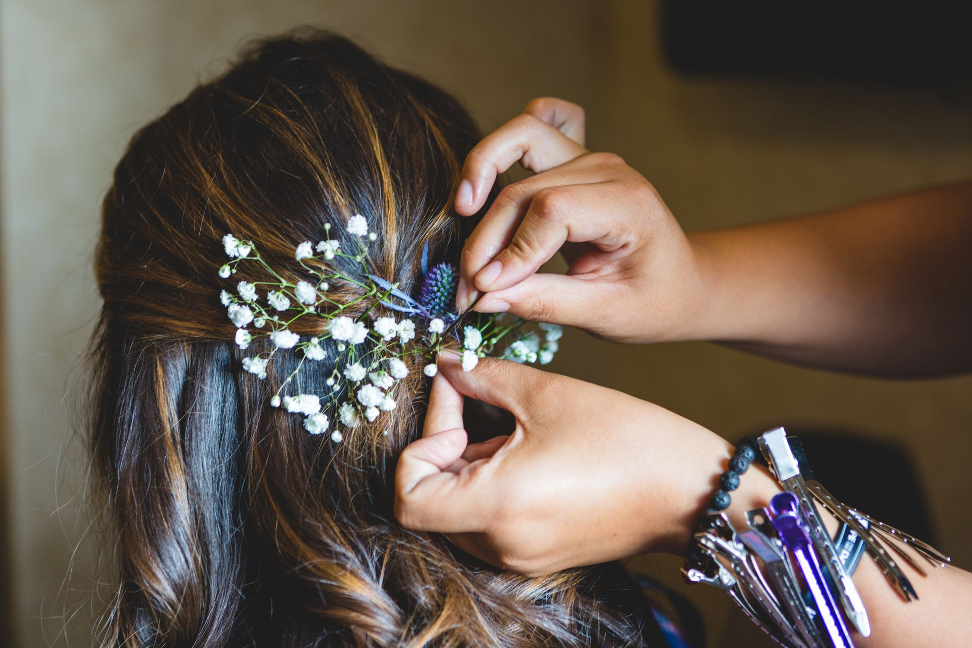 pinning-flowers-in-hair-QJ7F8SK.jpg