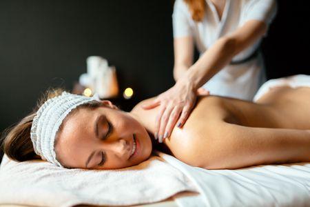 massage-therapist-massaging-woman-E6N7BPB.jpg