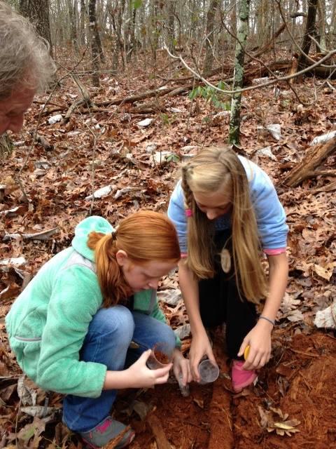 two girls explore dirt.jpg