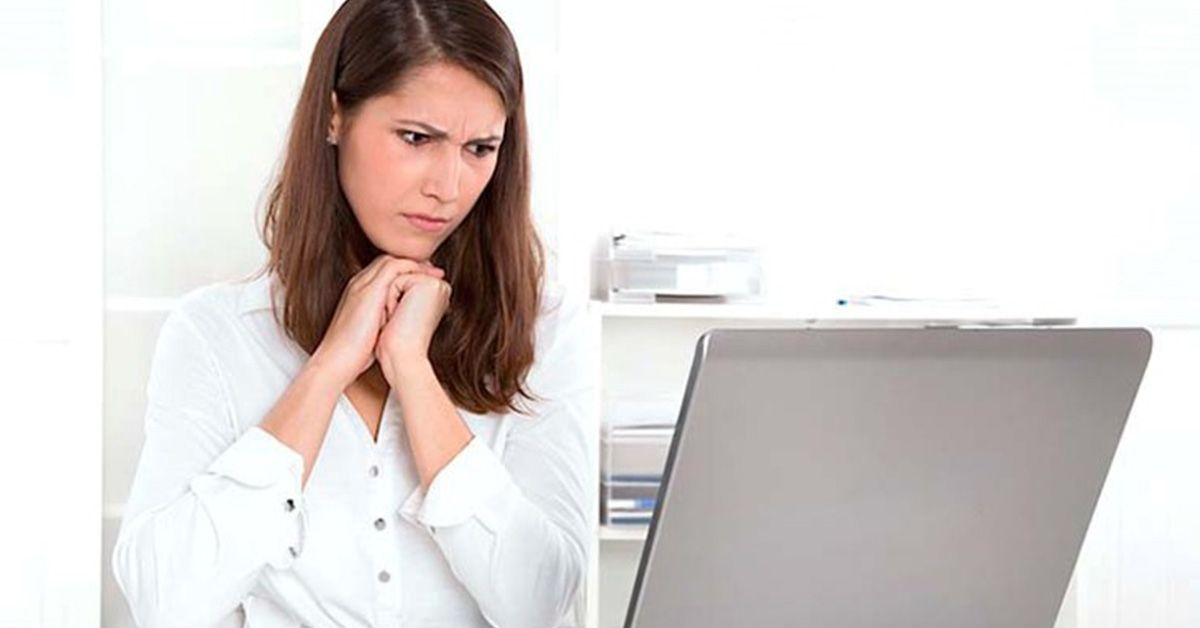 Woman looking upset at her computer