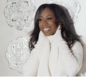 oleta adams white red carpet.jpg