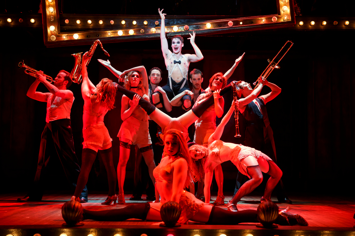 Randy Harrison as the Emcee and the 2016 National Touring cast of Roundabout Theatre Company's CABARET. Photo by Joan Marcus.jpg