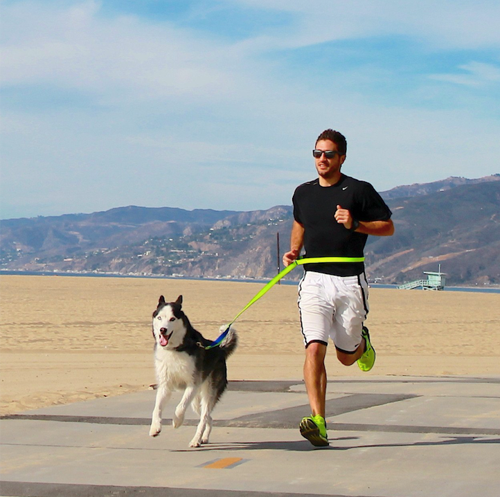 Man running with dog.png