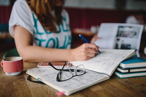kaboompics_Woman writing in her notebook.jpg