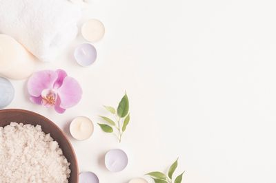bath-salt-with-orchid-flower-candles-white-backdrop_23-2147867845.jpg