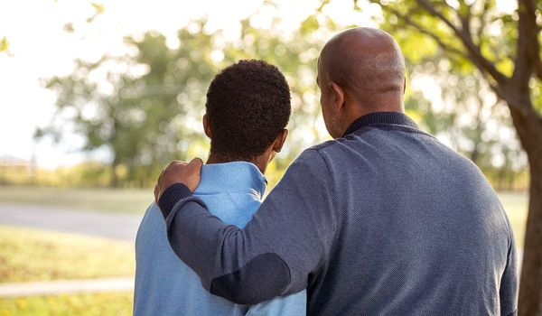 A-father-having-his-arm-around-his-son.jpg