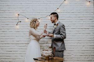 Wedding-Reception-Eating-Cake.jpg